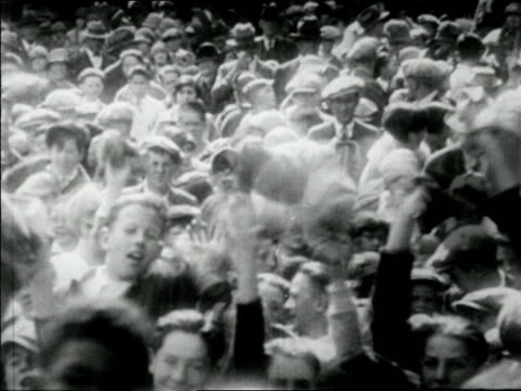 pan crowd of fans waving hats / newsreel - 1927 stock videos & royalty-free footage