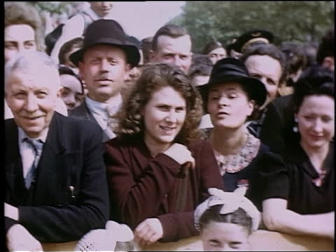 crowd of french civilians smiling and waiting behind a barricade / paris, france - barricade stock videos & royalty-free footage