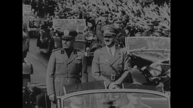 crowd of german officers outside fuhrerbau / nazi officers marching down street with probably adolf hitler and benito mussolini walking in front,... - benito mussolini stock videos & royalty-free footage