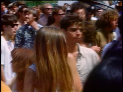 vídeos de stock e filmes b-roll de 1968 crowd of hippies dancing at outdoor rock concert / tapia park ca / newsreel - love in