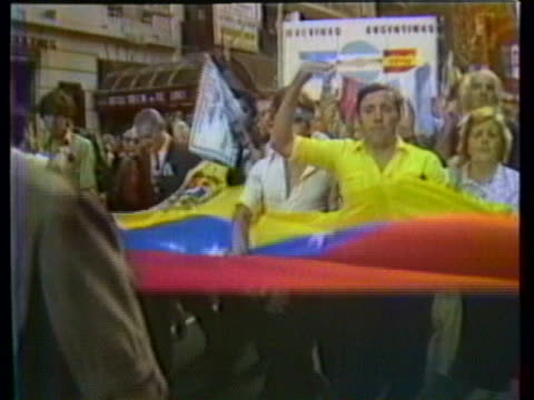 crowd of internationals and nationals marching in street of buenos aires zoom in to sign that says argentina the spaniards are with you in spanish... - argentina stock videos & royalty-free footage