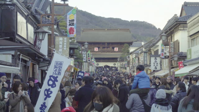 a crowd of japanese people in nagano - shinto shrine stock videos & royalty-free footage