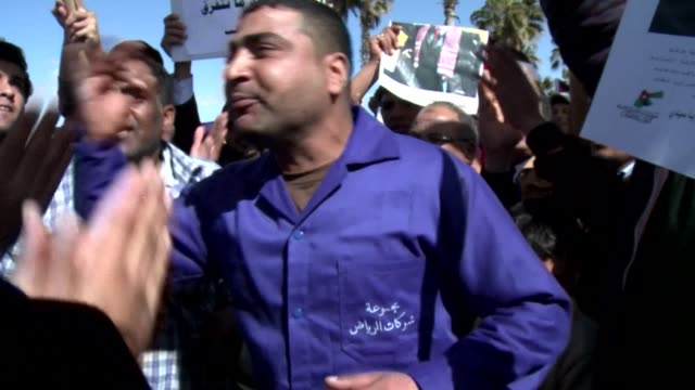 A crowd of Jordanians gathered on the airport road in Amman on Wednesday to greet Jordan's King Abdullah II who was returning from an official trip...