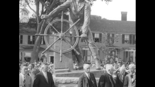 crowd of locals gathered around covered statue officers of the gloucester tercentenary permanent memorial association step into view / captain john a... - engraved image stock videos and b-roll footage