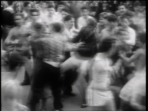 B/W 1931 crowd of male Columbia University students fighting on street outdoors / NYC / newsreel