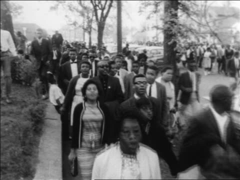 crowd of marchers on sidewalk in civil rights demonstration / alabama / newsreel - black civil rights stock videos & royalty-free footage