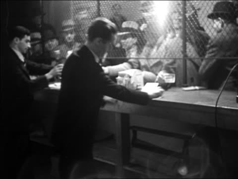 b/w 1933 crowd of men buying bottles of whiskey at liquor store / repeal of prohibition - ladies' night stock videos and b-roll footage