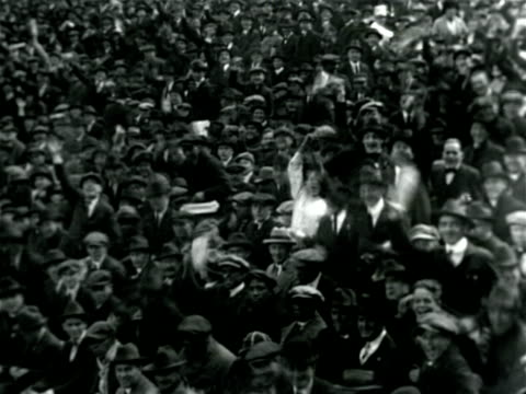 stockvideo's en b-roll-footage met b/w 1921 crowd of men cheering in polo grounds baseball stadium / documentary - 1921