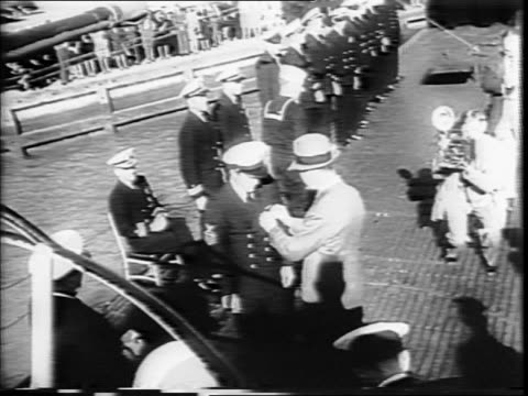 crowd of military men seated for ceremony / navy crew standing in a group during ceremony / navy secretary james v forrestall awarding an officer /... - william halsey stock-videos und b-roll-filmmaterial