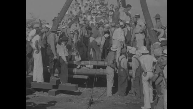 crowd of miners and others gathered outside mine, where 4 men are trapped 130 feet below the surface / mls body of deceased miner edward stoner jr,... - carbon monoxide stock videos & royalty-free footage