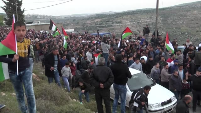 a crowd of mourners chanted slogans and waved palestinian flags friday in the west bank village of al walajah during the funeral of palestinian... - ramallah stock videos and b-roll footage
