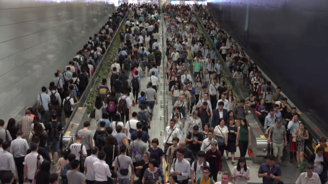 Crowd of pedestrian commuters on train station at Hong kong station