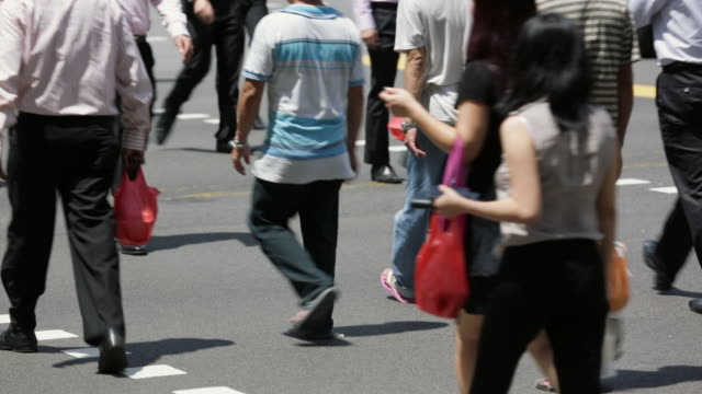 ms crowd of pedestrians at crosswalk - pedestrian stock videos & royalty-free footage