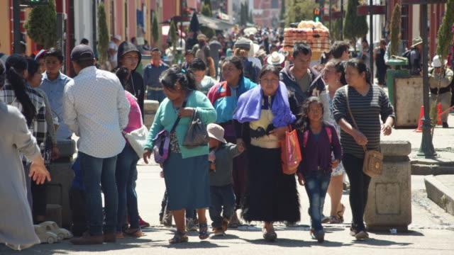 crowd of pedestrians walking down a pedestrian street in downtown san cristobal de las casas, chiapas, mexico - b roll stock videos & royalty-free footage