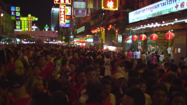 ms crowd of people at chinatown street festival at night, bangkok, ayuthaya, thailand - see other clips from this shoot 1448 stock videos and b-roll footage