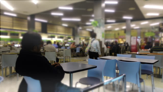 crowd of people at food center for lunch - food court stock videos and b-roll footage