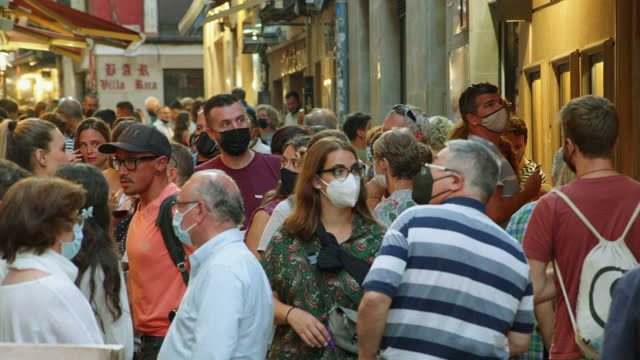 crowd of people at narrow street at logroño, spain during covid-19 crisis. summer august 2021. some people wearing mask - spanish culture stock videos & royalty-free footage