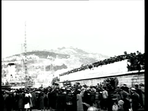 1918 b/w ws pan crowd of people at the port of yalta greeting troops from the white army on board the saratov ship during the russian civil war/yalta, crimea, ukraine - 1918 stock videos & royalty-free footage