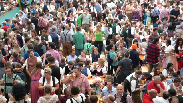 crowd of people celebrating in beer tent at oktoberfest in munich, germany - full stock videos & royalty-free footage