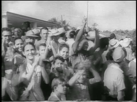 B/W 1959 crowd of people clapping cheering / postrevolution Havana / newsreel