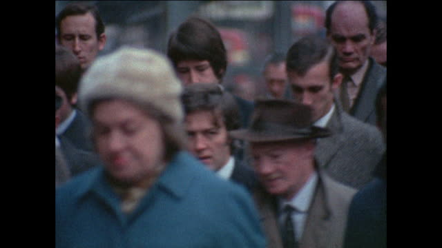 crowd of people, commuters in coats and hats walking - 1971 stock-videos und b-roll-filmmaterial