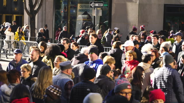 a crowd of people crosses the fifth avenue around the saks fifth avenue and rockefeller center in christmas holiday seasons at midtown manhattan new york ny usa on dec. 23 2018. - window display stock videos & royalty-free footage