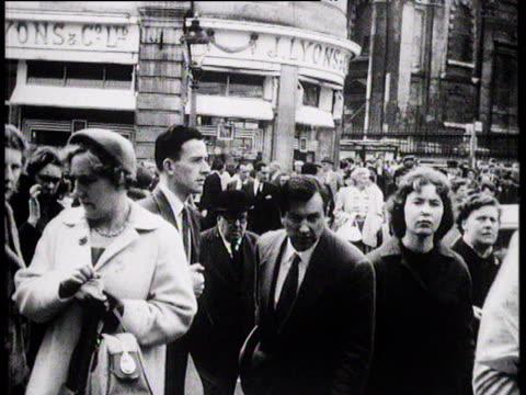 Crowd of people crossing road London 1957