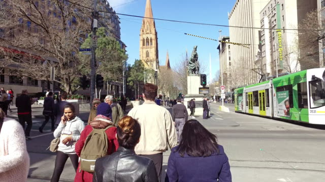 crowd of people crossing road - tram stock videos & royalty-free footage