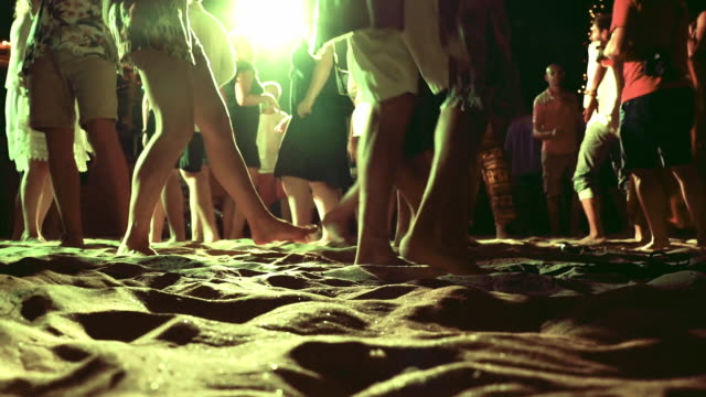 crowd of people dancing at night during beach party - low angle view stock videos & royalty-free footage