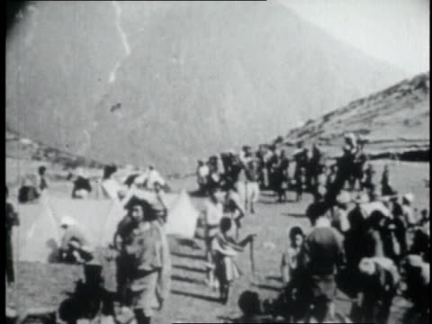 crowd of people gathering and setting up base camp on lower slopes of mount everest / nepal - tenzing norgay stock videos & royalty-free footage