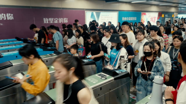 crowd of people in a hurry passes through electronic turnstiles at the metro station,xi'an,china. - paying stock videos & royalty-free footage