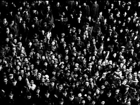 crowd of people in open square crowd 'flows' forward td crowd of people one waving nazi flag ws german nazi officers looking upward saluting waving... - drittes reich stock-videos und b-roll-filmmaterial