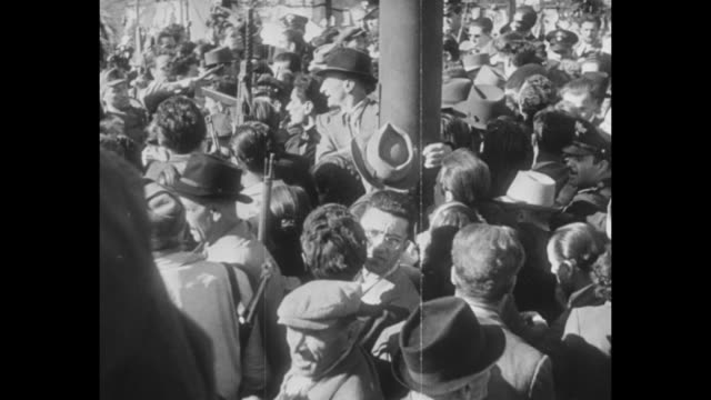 crowd of people in piazzale loreto in milan / bodies of benito mussolini and his mistress claretta petacci hang upside down at a gas station in the... - benito mussolini stock videos & royalty-free footage