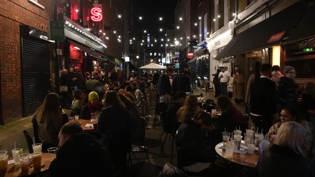 crowd of people in pub last night before lockdown caused by rapid increase of covid-19 cases in england. retail shops, bars and restaurants have one... - social distancing stock videos & royalty-free footage