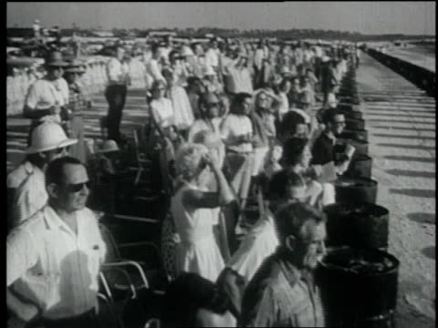 1957 montage crowd of people looks on as race cars complete 57th lap / nassau, bahamas - 1957 stock videos & royalty-free footage