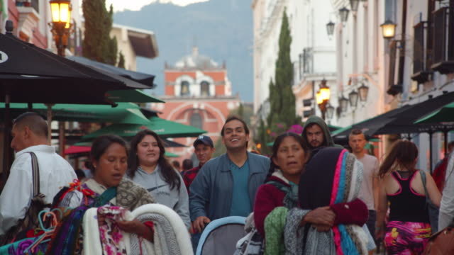 crowd of people on a busy walkway in san cristobal de las casas, chiapas, mexico. andador santo domingo el carmen - north american tribal culture stock videos & royalty-free footage