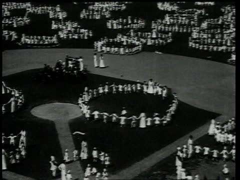 1918 ha crowd of people on baseball diamond dancing in circles / brooklyn, new york, united states - coney island brooklyn stock videos and b-roll footage