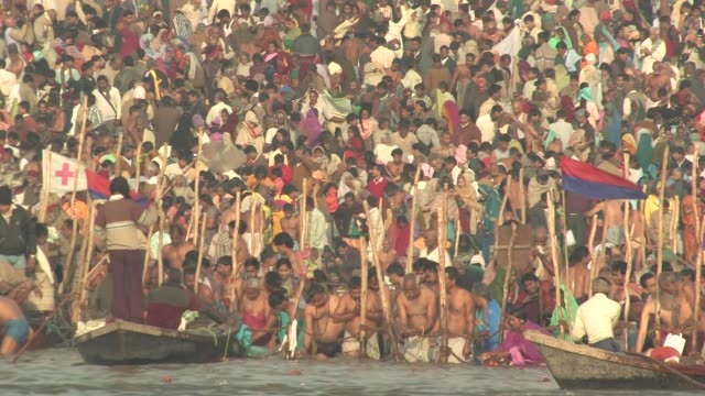 ms, crowd of people on riverbank taking ritual bath in ganges river, kumbh mela (pitcher festival), allahabad, uttar pradesh, india - riverbank stock videos & royalty-free footage