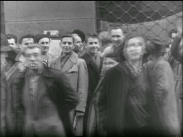 vidéos et rushes de crowd of people on street walk + look at camera / hungarian uprising - 1956