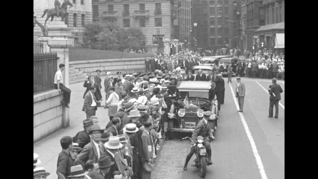 a crowd of people on the sidewalk of the massachusetts state house with waiting cars a motorcade leaves the gates following a motorcycle policeman... - convertible top stock videos & royalty-free footage