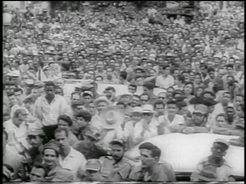 b/w 1959 crowd of people outdoors / some clapping / postrevolution havana / newsreel - 1959 stock videos and b-roll footage