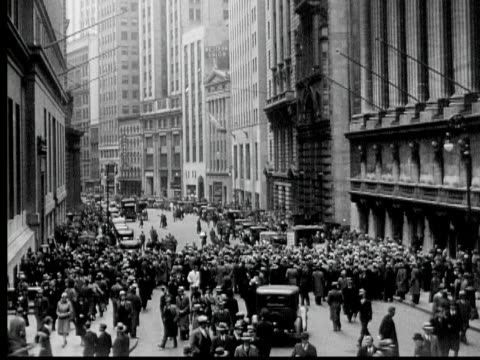 B/W 1933 MONTAGE MS WS TU Crowd of people outside New York Stock Exchange, Wall Street, New York City, New York State, USA, AUDIO
