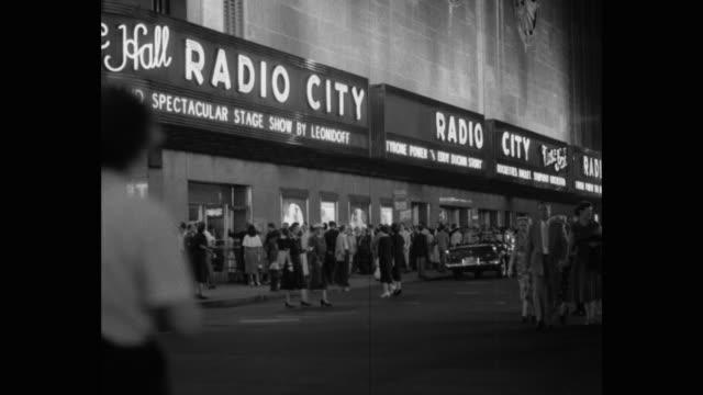 crowd of people outside radio city music hall, rockefeller center, midtown manhattan, new york city, new york state, usa - radio city music hall stock videos & royalty-free footage