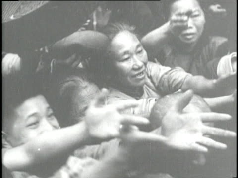 a crowd of people push and reach for food during a famine in china - hungrig stock-videos und b-roll-filmmaterial