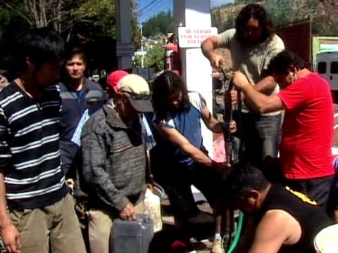 crowd of people queue for limited water supplies at pump following devastating earthquake in chile; 2 march 2010 - number of people stock videos & royalty-free footage