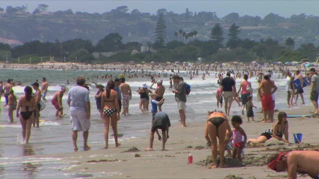 ms crowd of people relaxing on beach, coronado beach, san diego, california, usa - san diego stock-videos und b-roll-filmmaterial