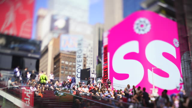 a crowd of people stays at the times square, which are surrounded by many illuminated billboards at new york ny usa on may. 21 2019. - advertisement stock videos & royalty-free footage