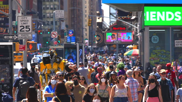 a crowd of people visits to the times square amidst pandemic of covid-19 - broadway manhattan stock videos & royalty-free footage