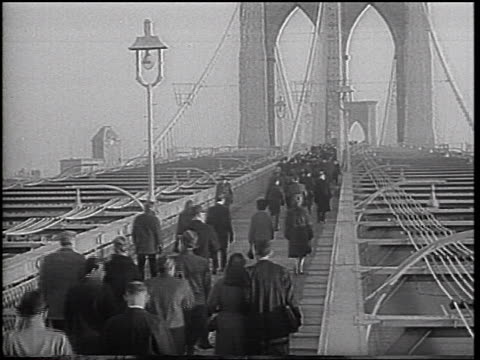 crowd of people walking across brooklyn bridge during transit strike - 1966 stock videos & royalty-free footage