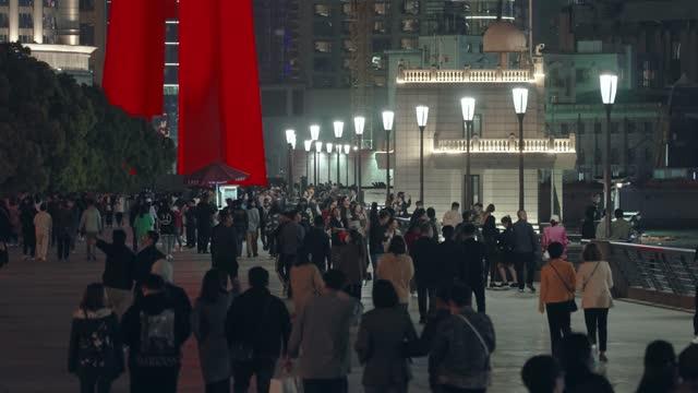 crowd of people walking along the bund in shanghai - walkable city stock videos & royalty-free footage